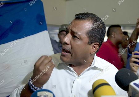 Opposition leader Felix Maradiaga (L), accused by a judge of organizing a criminal group and financing terrorism against the government of President Daniel Ortega, speaks to the media during his arrival to Managua, Nicaragua, 16 September 2019, after being exile for more than a year in United States.