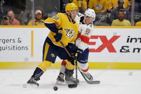 Jeremy Davies, Dryden hunt. Nashville Predators defenseman Jeremy Davies (38) and Florida Panthers left wing Dryden Hunt (73)vie for the puck during the third period of an NHL preseason hockey game, in Nashville, Tenn