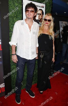 Stock Image of Nicollette Sheridan with boyfriend Jake