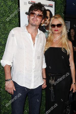 Stock Picture of Nicollette Sheridan with boyfriend Jake