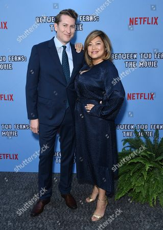 """Scott Aukerman, Kulap Vilaysack. Director Scott Aukerman, left, and Kulap Vilaysack arrive at the Los Angeles premiere of """"Between Two Ferns: The Movie"""" at ArcLight Hollywood on"""
