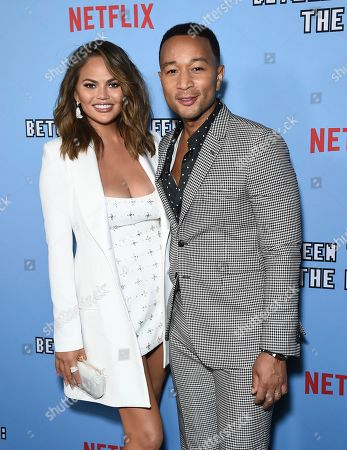 """Chrissy Teigen, John Legend. Chrissy Teigen, left, and John Legend arrive at the Los Angeles premiere of """"Between Two Ferns: The Movie"""" at ArcLight Hollywood on"""
