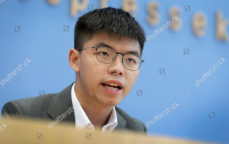 Hong Kong activist Joshua Wong addresses the media during a press conference in Berlin, Germany. Overseas, Joshua Wong has emerged as a prominent face of Hong Kong's months-long protests for full democracy. At home, he is just another protester