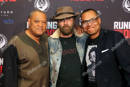 """Laurence Fishburne, Nicolas Cage, Jason Cabell. Laurence Fishburne, from left, Nicolas Cage and Jason Cabell attend the LA Premiere of """"Running with the Devil,"""" at the Writers Guild Theater, in Beverly Hills, Calif"""