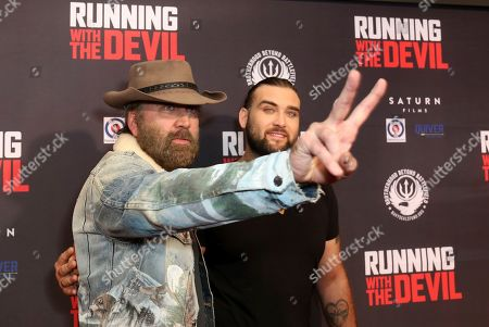"""Stock Picture of Nicolas Cage, Weston Cage Coppola. Nicolas Cage, left, and Weston Cage Coppola attend the LA Premiere of """"Running with the Devil,"""" at the Writers Guild Theater, in Beverly Hills, Calif"""