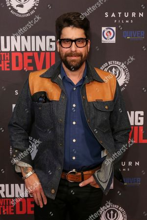 """Adam Goldberg attends the LA Premiere of """"Running with the Devil"""" at the Writers Guild Theater, in Beverly Hills, Calif"""