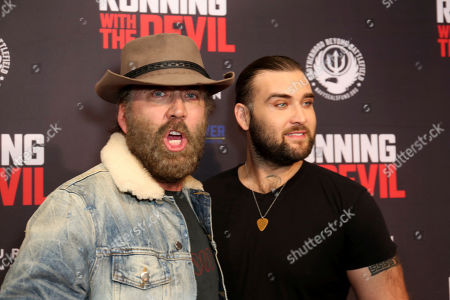 """Nicolas Cage, Weston Cage Coppola. Nicolas Cage, left, and Weston Cage Coppola attend the LA Premiere of """"Running with the Devil"""" at the Writers Guild Theater, in Beverly Hills, Calif"""