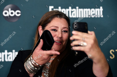 """Camryn Manheim, a cast member in the ABC television series """"Stumptown,"""" films herself at the premiere of the show at the Petersen Automotive Museum, in Los Angeles"""