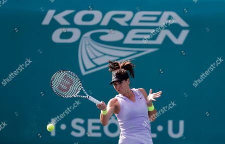 Ajla Tomljanovic, Stefanie Voegele. Ajla Tomljanovic of Australia returns a shot to Stefanie Voegele of Switzerland during their first round match of the Korea Open tennis championships in Seoul, South Korea