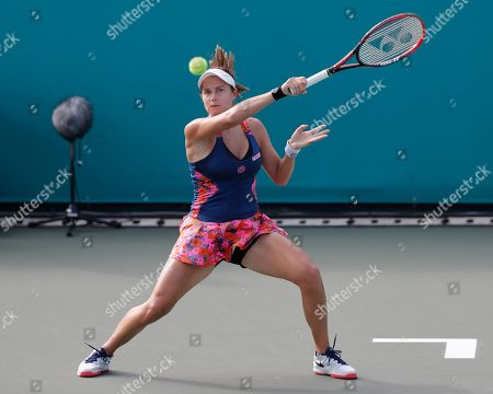Stock Picture of Ajla Tomljanovic, Stefanie Voegele. Stefanie Voegele of Switzerland returns a shot to Ajla Tomljanovic of Australia during their first round match of the Korea Open tennis championships in Seoul, South Korea