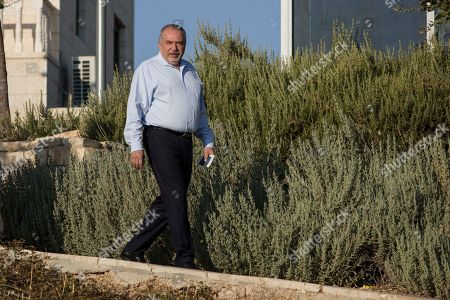 The leader of the Yisrael Beiteinu (Israel Our Home) right-wing nationalist party Avigdor Liberman arrives to votein the settlement of Nokdim, West Bank