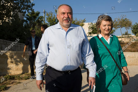 The leader of the Yisrael Beiteinu (Israel Our Home) right-wing nationalist party Avigdor Liberman come to vote with is wife Ella in the settlement of Nokdim, West Bank