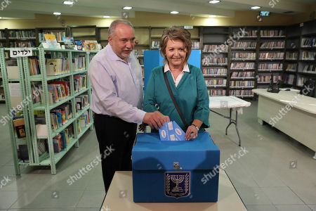 The leader of the Yisrael Beiteinu (Israel Our Home) right-wing nationalist party Avigdor Liberman votes with is wife Ella in the settlement of Nokdim, West Bank