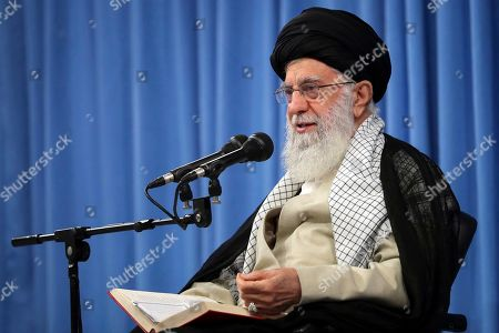 """In this photo released by an official website of the office of the Iranian supreme leader, Supreme Leader Ayatollah Ali Khamenei speaks in a meeting in Tehran, Iran, . Iran's supreme leader announced on Tuesday that """"there will be no talks with the U.S. at any level"""" ? remarks apparently meant to end all speculation about a possible U.S.-Iran meeting between the two countries' presidents at the U.N. later this month"""