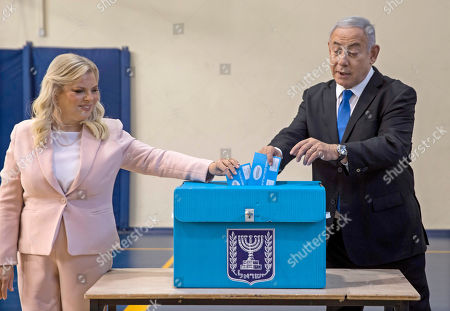 Stock Picture of Israeli Prime Minister Benjamin Netanyahu (R) and his wife Sara Netanyahu (L) cast their ballots during the Israeli legislative elections, at a polling station in Jerusalem, 17 September 2019. Israelis are heading to the polls for a second general election, following the prior elections in April 2019, to elect the 120 members of the 22nd Knesset, or parliament. According to the Israel Central Bureau of Statistics, about six million people are eligible to vote.