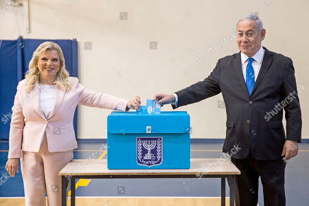 Israeli Prime Minister Benjamin Netanyahu (R) and his wife Sara Netanyahu (L) cast their ballots during the Israeli legislative elections, at a polling station in Jerusalem, 17 September 2019. Israelis are heading to the polls for a second general election, following the prior elections in April 2019, to elect the 120 members of the 22nd Knesset, or parliament. According to the Israel Central Bureau of Statistics, about six million people are eligible to vote.