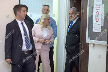 Stock Image of Israeli Prime Minister Benjamin Netanyahu (R) and his wife Sara Netanyahu (C) arrive at a polling station to vote in the Israeli legislative elections, in Jerusalem, 17 September 2019. Israelis are heading to the polls for a second general election, following the prior elections in April 2019, to elect the 120 members of the 22nd Knesset, or parliament. According to the Israel Central Bureau of Statistics, about six million people are eligible to vote.