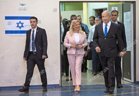 Israeli Prime Minister Benjamin Netanyahu (R) and his wife Sara Netanyahu (C) arrive at a polling station to vote in the Israeli legislative elections, in Jerusalem, 17 September 2019. Israelis are heading to the polls for a second general election, following the prior elections in April 2019, to elect the 120 members of the 22nd Knesset, or parliament. According to the Israel Central Bureau of Statistics, about six million people are eligible to vote.