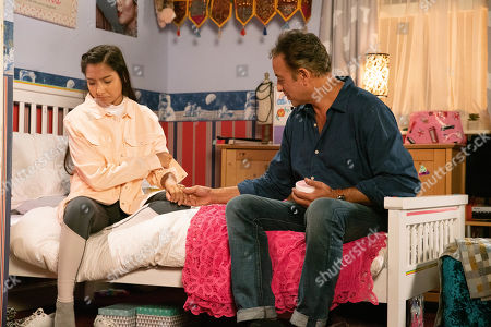 Ep 9891 Friday 4th October 2019 - 1st Ep When a parcel arrives in Asha Alahan's, as played by Tanisha Gorey, name, Dev Alahan's, as played by Jimmi Harkishin, tears it open and is stunned to find a bottle of skin lightening cream. Ordering Asha to roll up her sleeves, Dev's shocked at the sight of Asha's red raw skin.