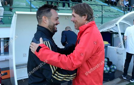 Manager Daniel Poyatos Algaba of Real Madrid U19 and Coach Stephane Roche of Paris Saint-Germain U19