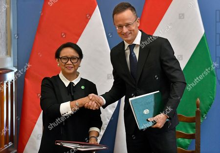 Hungarian Minister of Foreign Affairs and Trade Peter Szijjarto (R) and Indonesian Foreign Minister Retno Marsudi shake hands after they signed an agreement in the Ministry of Foreign Affairs and Trade in Budapest, Hungary, 17 September 2019.