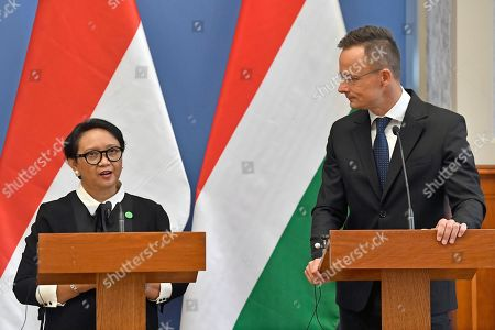 Hungarian Minister of Foreign Affairs and Trade Peter Szijjarto (R) and Indonesian Foreign Minister Retno Marsudi hold a joint press conference after their meeting in the Ministry of Foreign Affairs and Trade in Budapest, Hungary, 17 September 2019.