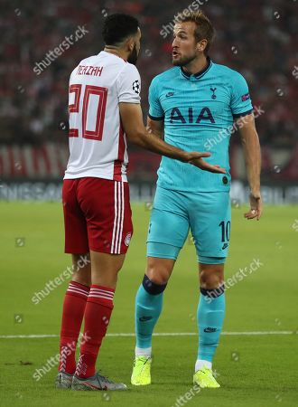 Harry Kane of Tottenham Hotspur and Yassine Meriah of Olympiakos argue over the penalty decision