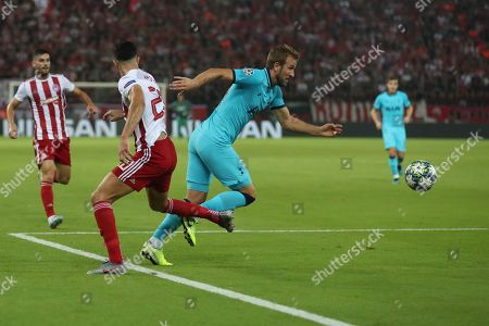 Harry Kane of Tottenham Hotspur is fouled by Yassine Meriah of Olympiakos for penalty