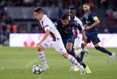 Ander Herrera of Paris Saint-Germain beats Casemiro of Real Madrid