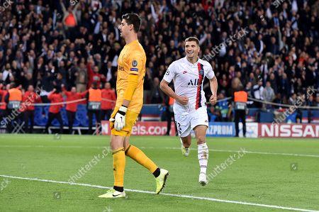 Thomas Meunier of Paris Saint-Germain celebrates scoring the 3rd goal 3-0 as he runs past Goalkeeper Thibaut Courtois of Real Madrid