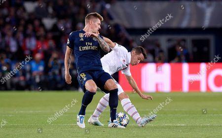 Ander Herrera of Paris Saint-Germain beats Toni Kroos of Real Madrid