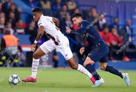 Presnel Kimpembe of Paris Saint-Germain and James Rodriguez of Real Madrid