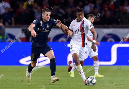 Gareth Bale of Real Madrid chases Presnel Kimpembe of Paris Saint-Germain