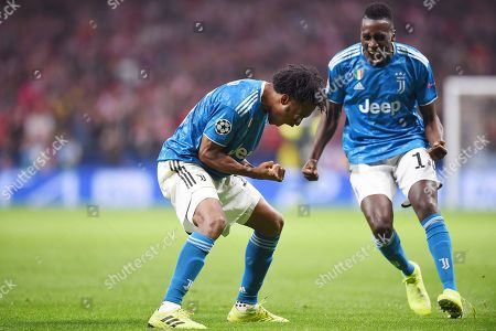 Juan Cuadrado of Juventus celebrates his goal with his teammate Blaise Matuidi