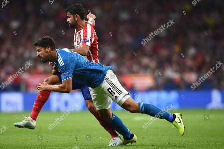 Diego Costa of Atletico de Madrid and Sami Khedira of Juventus