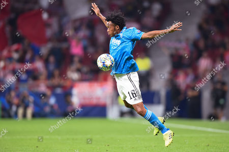 Juan Cuadrado of Juventus controls the ball in the air