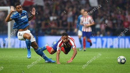 Renan Augusto Lodi of Atletico de Madrid and Alex Sandro of Juventus