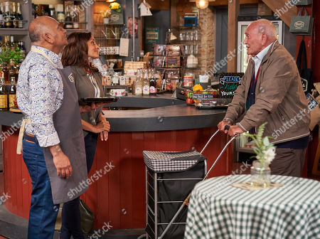 Ep 8597 Thursday 19th September 2019 - 1st Ep  Rishi Sharma, as played by Bhasker Patel, hands out chocolate samples from his new venture as Manpreet Sharma, as played by Rebecca Sarker, bumps into Derek, as played by Tommy Cannon, a regular patient at the surgery.