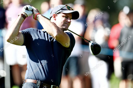 Ex cricketer Andrew Strauss during his round.