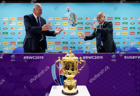 World Rugby Chairman Bill Beaumont (L) throws a rugby ball to Japan Rugby Football Union President Shigetaka Mori during the Rugby World Cup 2019 opening press conference in Tokyo, Japan, 17 September 2019. The Rugby World Cup 2019 will kick-off on 20 September.