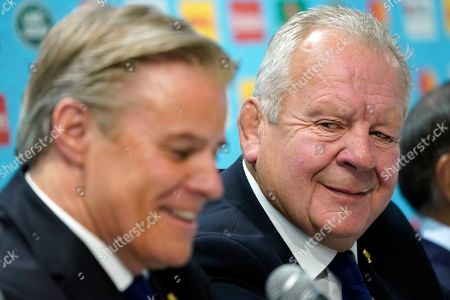 World Rugby Chairman Bill Beaumont (R) shares a smile with World Rugby CEO Brett Gosper during the Rugby World Cup 2019 opening press conference in Tokyo, Japan, 17 September 2019. The Rugby World Cup 2019 will kick-off on 20 September.