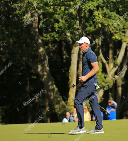 VIRGINIA WATER, ENGLAND. 18 SEPTEMBER 2019: retired cricket player Shane Warne competing in the ProAm of the BMW PGA Championship, European Tour Golf Tournament at Wentworth Golf Club, Virginia Water, Surrey, England.
