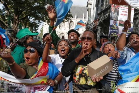 Stock Photo of Members of the Democratic Republic of the Congo (DRC) Diaspora take part in a protest during the official visit of DRC President Tshisekedi in Brussels, Belgium, 17 September 2019. Demonstrators complained about DRC President Tshisekedi's alliance with former president Joseph Kabila.