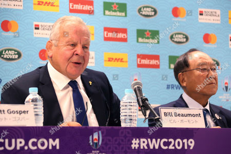 Chairman of World Rugby Bill Beaumont, left, speaks as Chairman of Rugby World Cup 2019 Organizing Committee Fujio Mitarai listens during a press conference of Rugby World Cup 2019 in Tokyo