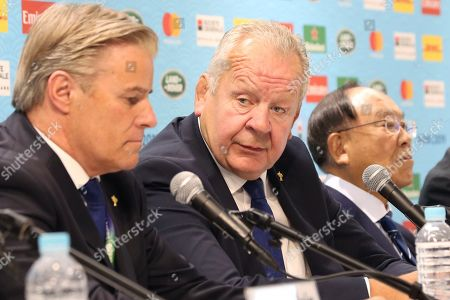 From left, Chief Executive Officer of World Rugby Brett Gosper, Chairman of World Rugby, Bill Beaumont and Chairman of Rugby World Cup 2019 Organizing Committee Fujio Mitarai, attend a press conference of Rugby World Cup 2019 in Tokyo