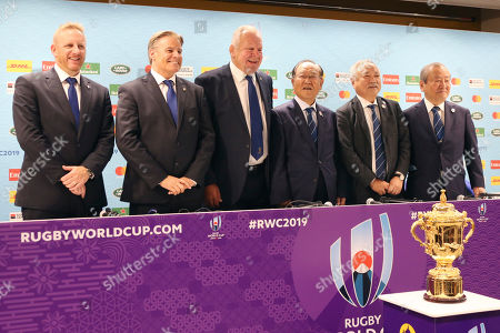 From left, Chief Operating Officer of World Rugby Alan Gilpin, Chief Executive Officer of World Rugby Brett Gosper, Chairman of World Rugby Bill Beaumont, Chairman of Rugby World Cup 2019 Organizing Committee Fujio Mitarai, President of Japan Rugby Football Union Shigetaka Mori, and Chief Executive Officer of Rugby World Cup 2019 Organizing Akira Shimazu pose for a photo during a press conference of Rugby World Cup 2019 in Tokyo