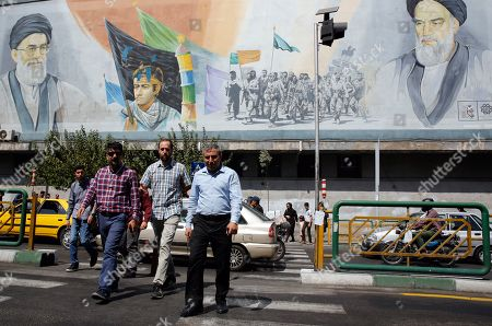 Iranian people walk near a wall painting of Iranian late supreme leader Ayatollah Ruhollah Khomeini (top-R) and Iranian supreme leader Ayatollah Ali Khamenei (top-L) in a street of Tehran, Iran, 17 September 2019. According to media reports, the supreme leader said that there will be 'no negotiations with the US in any level' ahead of a United Nations General Assembly this month after the White House left open the possibility of a potential meeting.