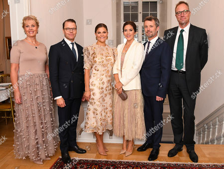 Marianne Jorgensen, Prince Daniel, Crown Princess Victoria, Crown Princess Mary and Crown Prince Frederik arrive for a dinner at the Swedish ambassador's residence of Fredrik Jorgensen (far right)
