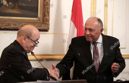 French Foreign Minister Jean-Yves Le Drian (L) shakes hands with his Egyptian counterpart Sameh Shoukry (R) during a joint press conference in Cairo, Egypt, 17 September 2019.