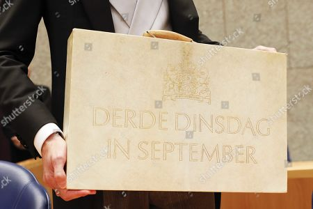 Stock Picture of Minister Wopke Hoekstra of Finance presents the suitcase with the government budget and a million memorandum on Prinsjesdag (Prince's Day) in the House of Representatives, in The Hague, the Netherlands, 17 September 2019.